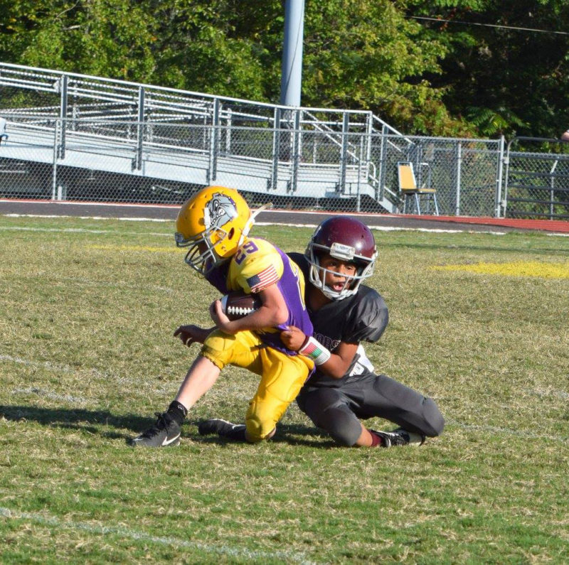 Brian Anderson drags down the Bulldogs ball carrier.